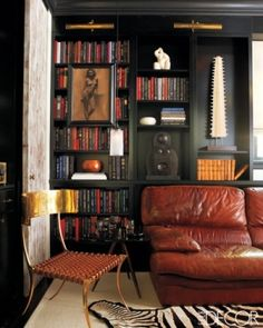 This cognac couch looks cozy! Not sure about its placement in front of the bookshelf though