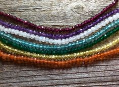 Multicolor gemstone beads in rainbow stacking by FlatCatGems