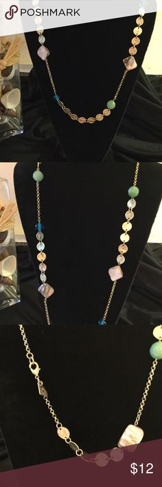 ParkLane jewelry close outs 28 inch multi colored stone and gold tone disc, necklace, worn as a single strand or doubled. Has a lobster claw clasp. Jewels are turquoise light green, mother of pearl, and gold tone disc. Park Lane Jewelry Necklaces