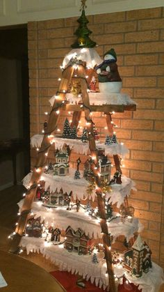 DIY decorating: 101 Christmas DIY Decorations Easy and Cheap christmas crafts for adults handmade gifts 101 Christmas DIY Decorations Easy and Cheap Easy Christmas Decorations, Christmas Village Display, Christmas Villages, Christmas Ornaments, Ladder Christmas Tree, Outdoor Decorations, Diy Christmas Lights, Christmas Decorations Apartment Small Spaces, Diy Christmas Decorations For Home