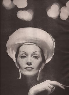 Dovima, The Big Beautiful Hats of Paris, by Richard Avedon, 1950s