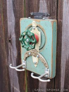 The arched ornament on this one came from the clasp of a vintage small purse.