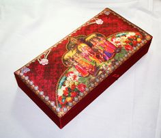 The Krishna and her gopis on wedding invitation box - epitome of love