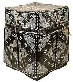 "Balinese basket painted on both sides by hand, these beautiful baskets double as storage and decoration for any room. Stash your treasures, magazines or use as a side table-showing off their Indian Mowar and Prodo designs.    17"" High x13""Square  Hand-Painted  Indonesia"