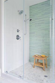 Sea green glass tile, white subway tile, frameless shower door, marble mosaic floor tile