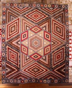 Reproduction of 1830-1860 quilt.  Hexagons are 1 cm on a side.