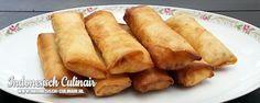 Loempia - Groenten en kip gerold in loempia velletjes. Vervang de kip eens door tahoe of tempeh, of laat gewoon weg.