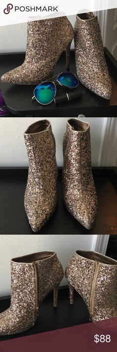 Glitter booties Shine sparkle dazzle in these closed toed glitter heels! Guaranteed to be the center of attention• perfect outfit for New Years, birthday, weddings, etc etc etc • size 9 • zipper on sides in great condition • comes with box • heel height about 4 inches Shoes Ankle Boots & Booties