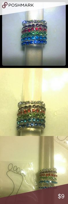New Pick 2 Birthstone Invisible Toe Rings Pick any 2 Brand New Birthstone Crystals set in Silver Invisible Toe Rings. One Size fits all. Available are : February -Amethyst, April - Diamond, July - Ruby, August - Peridot, September - Sapphire, & Aquamarine -December.  All reasonable offers are considered and appreciated Thanks Swim Rings
