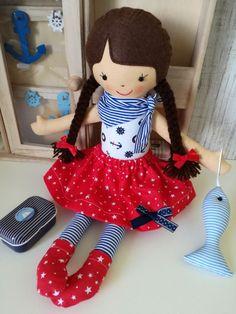 Текстилна кукла с аксесоар рибка. Височина 36-37см. Материали - памучни платове, филц, сил.пух, пандели, мъниста. За деца 3+