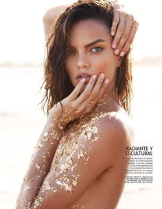 Victoria's Secret model Barbara Fialho shines like gold in her latest spread featured in the April 2016 issue of Vogue Mexico. Photographed by Enrique Vega, the Brazilian stunner heads to the beach in metallic swimsuits and accessories. Stylist Karin Elgair makes sure Barbara dazzles in the designs of Norma Kamali, Swarovski and Chanel. For beauty, …