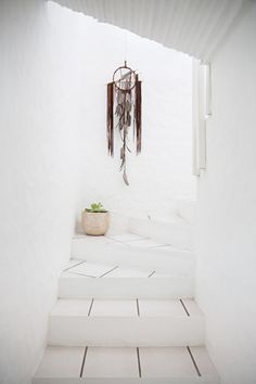 I love the idea of having a funky dream catcher hanging down as you walk up the stairs to the second floor!