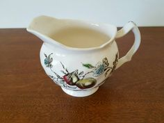 Check out this item in my Etsy shop https://www.etsy.com/listing/257246579/vintage-johnson-bros-creamer-georgia
