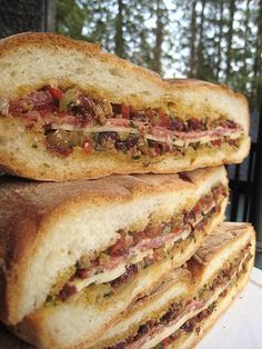 muffaletta recipe including and olive salad to go inside the sandwich.this is perfect for a deck party :) Muffuletta Recipe, Muffuletta Sandwich, Cajun Recipes, Italian Recipes, Cooking Recipes, Olive Recipes, Soup And Sandwich, Sandwich Recipes, Sandwich Buffet
