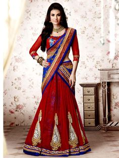 Glowing red and blue color net and chiffon #Lehenga style saree garnished with golden zari work. Item Code: SAV3737 http://www.bharatplaza.com/new-arrivals/sarees.html