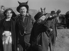 "Kathleen O'Malley, Ward Bond and Jane Darwell (Blowing horn) in ""Wagon Master"" (1950)"