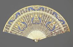 Circa 1820 Ivory brisé fan, painted and fretted, French, via  Fitzwilliam Museum.