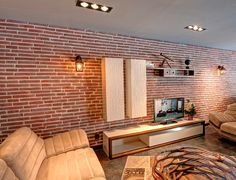Rosso brick tiles for this lounge feature wall