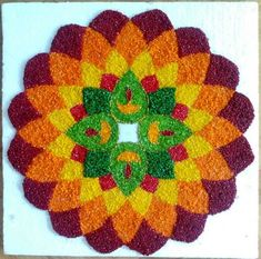 I uploaded another rangoli made with coloured rice.Some of you had a doubt that whether it is a rice or paint or rice powder. Rangoli Designs Latest, Simple Rangoli Designs Images, Rangoli Designs Flower, Small Rangoli Design, Rangoli Ideas, Colorful Rangoli Designs, Rangoli Designs Diwali, Diwali Rangoli, Flower Rangoli