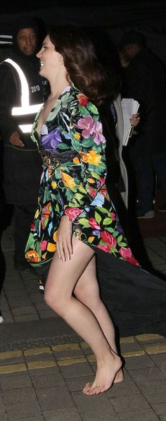 Forget something? Lana Del Rey emerged from Tape without her shoes on, carrying the purple stilettos in her hand and walking barefoot along the cold London pavement