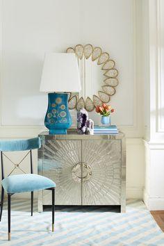 Jonathan Adler, Spring 2015, blue velvet accent chair, blue geometric chevron rug, blue accent lamp and brass teardrop mirror, credenza, vignette, stylish homes, luxury, interior designer