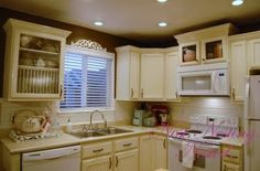 refinishing cabinets- what a great idea, she used beadboard in the recessed parts of the cabinet door to add texture and then moulding around the edges. This looks fabulous and… Glazing Cabinets, Diy Cabinets, Painting Kitchen Cabinets, Refinished Cabinets, Cream Cabinets, Custom Cabinets, Diy Kitchen, Kitchen Decor, Updated Kitchen