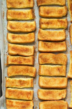 Oven french toast sticks lined up on baking dish
