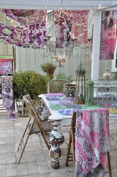 Love the table and chandy, not to mention the textiles.