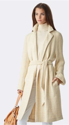 Lightweight linen-and-silk tweed and a neutral hue make the textural Sidney coat ideal for transitional seasons. Layer the unlined wrap style, which secures with a waist-defining self-belt, over tonal separates for an effortlessly elegant look.