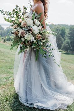 Vintage Pink and Blue Summer Bridal Inspiration with an Oversized Bouquet https://heyweddinglady.com/vintage-pink-summer-blue-heirloom-wedding-shoot/ #wedding #weddings #weddingideas #engaged #summerweddings #blueweddings #blueweddingdress #weddingdress #brides #bridalphotos #bridalbouquets #coloredweddingdresses