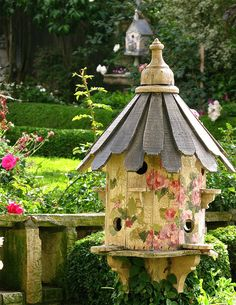 Love the painted flowers on the birdhouse ...beautiful  composition ...it's gorgeous!