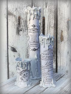 These creepy candles are actually paper towel rolls and printed graphics!