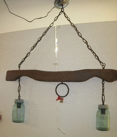 calf yoke converted into a ceiling light fixture great for a cabin farm house