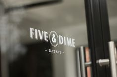 Five & Dime by Bravo Company for a restaurant/café in Singapore. A coin is used as a visual representation of the name. Five & Dime refers to a variety store where everything is sold for 5 or 10 cents. I loive the color palette, the logo, typeface selections... everything is so well designed and makes me want to be there! - restaurant window