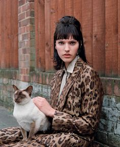 Maggie Jablonski in Dries Van Noten with a furry friend photographed by Kai Z Feng for Elle UK, August 2016.