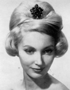 Evening hairstyle with central bouffant and jewel