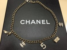 Chanel Iconic Charms Choker Necklace. Get the lowest price on Chanel Iconic Charms Choker Necklace and other fabulous designer clothing and accessories! Shop Tradesy now