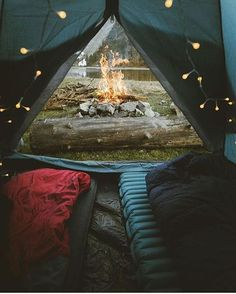 Camping with fairy lights and a bonfire by the lake