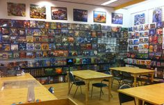 The Board Game Family Uncles Games Comic Book Crafts, Store Shelving, Game Cafe, Pie In The Sky, Kitty Games, Coffee Shops, Family Games, Game Room, Board Games