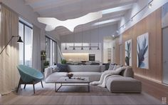 Living room combination of flowing curves and crisp edges. Linear shapes define the primary seating area but the suspension lamp influences the entire room with its fluidity.