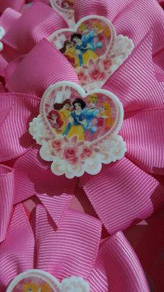 Disney Princess hair bows party favours - on hot pink pinwheel bows - The perfect thank you! Available at Bella's Bows.