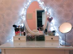 this is what i wanna do with the Hemnes dressing table i'll be getting from ikea! Fairy ligts for the win!