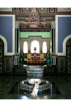 Villa Oasis a view through a pair of painted doors into the library.  Marrakech.  Photo by Oberto Gill.