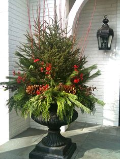 XMAS: Love this Christmas Urn . even a little Christmas tree in the middle! Christmas Urns, Outdoor Christmas Decorations, Winter Christmas, All Things Christmas, Christmas Holidays, Christmas Crafts, Christmas Greenery, Christmas Ideas, Winter Porch
