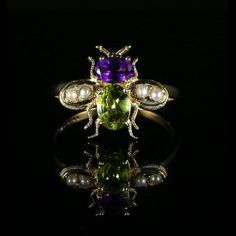This gorgeous Amethyst & Peridot suffragette bee / insect ring is 18ct yellow gold and silver.  Made in the suffragette / Victorian style  Boasting two beutiful gemstones over 0.75ct each.  Suffragettes liked to be depicted as feminine. Their jewellery was chosen to counter the stereotypes put forward by opponents that they were mannish or shrieking!  Green is for give, white is for women and violet is for votes.  The peridot is a stone of lightness and beauty and was believed t...