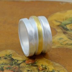 Wide-silver-ring-w-gold Handmade Sterling Silver, Sterling Silver Rings, Silver Jewelry, Wide Rings, Matte Gold, Gold Bands, Sterling Silver Thumb Rings, Gold Stripes, Silver Jewellery