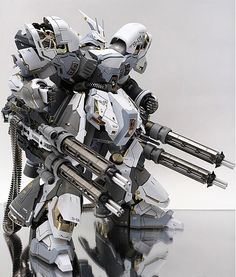 GUNDAM GUY. An impressive model of the robot in a gray-steel armor