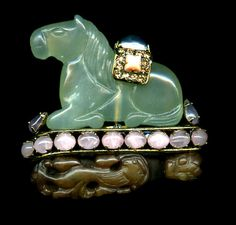 Iradj Moini serpentine and rose quartz horse brooch with crystals and faux coral. The Robin Deutsch Collection