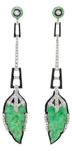 A pair of Art Deco earrings, composed of platinum, carved jades, enamel and, and rose-cut diamonds, circa 1920. #ArtDeco #earrings