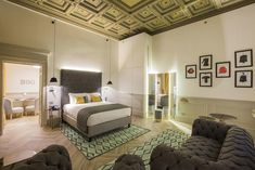 This boutique hotel, located near the fashion district, has interiors inspired by vintage fashion house Biki, one of the most notable names of the Milan fashion scene in the 30s, 40s and 50s. Throughout the historic palace, intricately detailed classically coffered ceilings and panelled walls can be seen, lending to the classical era of the hotel. Large arches dominate throughout and surround the interior courtyard, making it the perfect place for an afternoon coffee or drink.